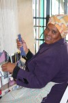 Woman weaving at the Philani Development Centre and Craft Shop in Khayelitsha township.