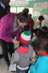 Jazmin handing out stickers to a kindergarten class at the Philani Development Centre and Craft Shop in Khayelitsha township.