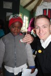 Vinny handing out stickers to a kindergarten class at the Philani Development Centre and Craft Shop in Khayelitsha township.