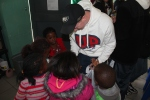 Evan handing out stickers to a kindergarten class at the Philani Development Centre and Craft Shop in Khayelitsha township.