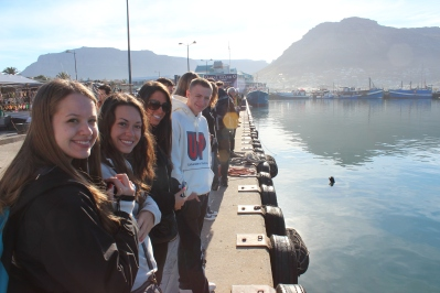Chrystal, Emily, Larisa, & Vinny looking at the seals at Hout's Bay. Cape Peninsula Tour