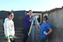 Jazmin, Bobby, & Michelle getting ready to repair roofs.