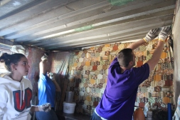 Jazmin & Bobby repairing roofs.