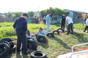 Evan, Larisa, Emily, Peter, Vinny, & Ryan working on the tires for the playground.
