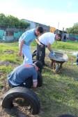 Evan, Peter, & Ryan putting concrete into tires.