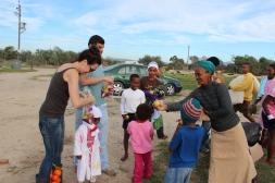 Tamarin & Peter distributing apples & oranges.