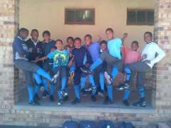 Members of the Vaaijies Primary School soccer team showing off their new cleats.