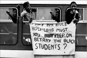 Students hold a sign