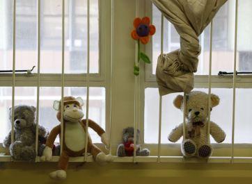 Stuffed animals on windowsill at Teddy Bear Clinic, where abused women are treated in Johannesburg. (AP Photo/ Denis Farrell)