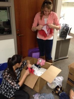 Adriana & Alison organizing donations.