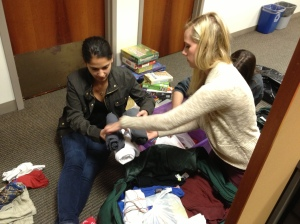 Lauren & Kristyn packing donations.