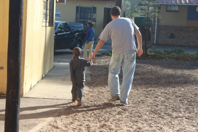 Peter walking a student back to class