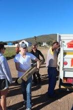 Alison & Lauren unloading truck in Melkbosplaas