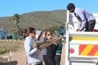 Libby & Melanie reloading truck