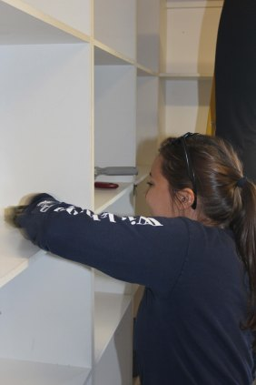 Libby scrubbing the shelves of the library at the Vaatjie Primary School.