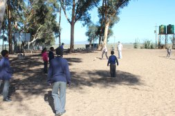 Isabelle, Lauren, & Peter playing soccer with the students at the Vaatjie Primary School during a break.