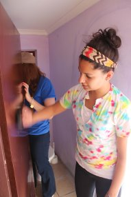 Lauren painting the inside of the girls' bathroom at the Vaatjie Primary School.