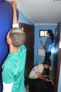 Putting finishing touches on boys' bathroom at Vaatjie Primary School.