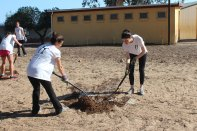 Lacey & Jenna spreading compost onto soccer field.