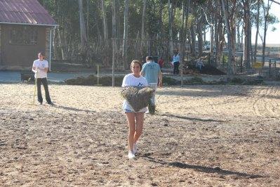 Melanie moving sod to the soccer field at Vaatjie Primary School.