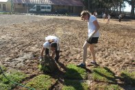 Adriana & Alison moving sod to the soccer field at Vaatjie Primary School.