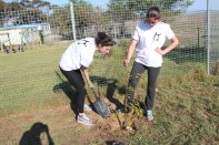 Jenna & Jessica planting a tree in the Vaatjie Primary School Garden.