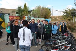 Our bicycle tour guide Thando introduces the QU301 South Africa students to Soweto township.