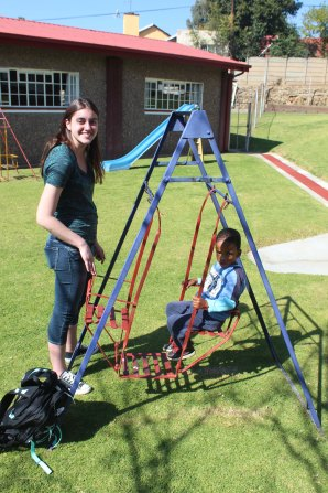 Jessica pushing child on swing