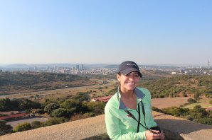 Adriana on top of Voortrekker Monument with Pretoria in background