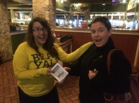 Angelique talking to QU administrator Erin about fundraiser.