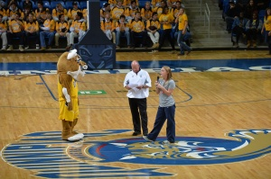 Taylor talking about the QU South Africa Holiday Camp Raffle at Bobcat Madness