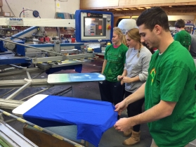 Anthony, Taylor & Kat working on pressing the backs of the T-shirts